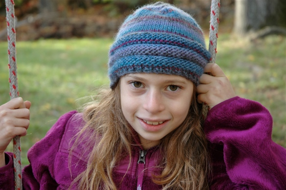 Knit hat with garter stitch band is so stretchy that it can fit an older child or adult.