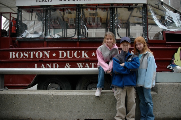 Triplets, age 10, about to go on a Boston Duck Tour (land and water tour)