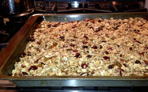 spread granola on baking sheet, now its ready to bake