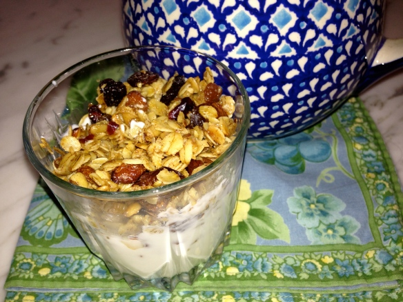 Homemade Granola on top of vanilla yogurt.  Yum!