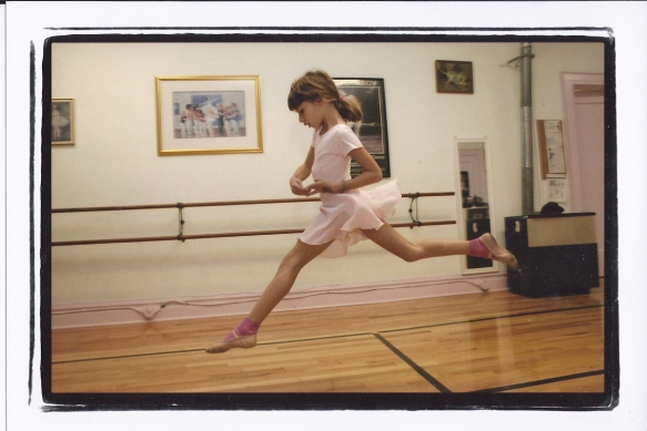 Leaping at ballet class.