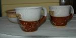 wheel-thrown mugs and a bowl