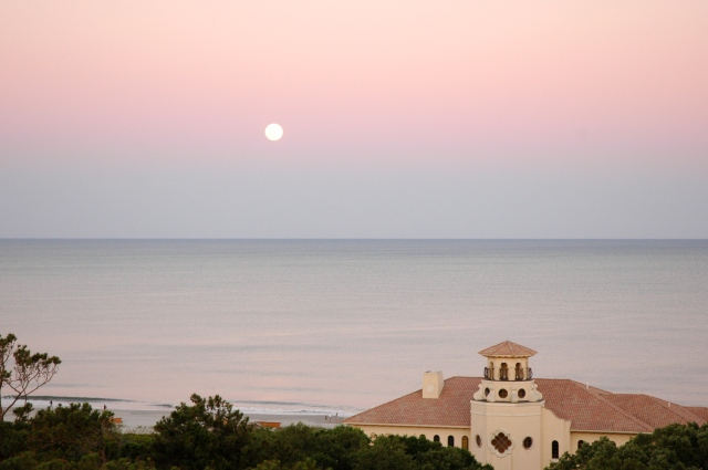 Full moon in the sunset sky.