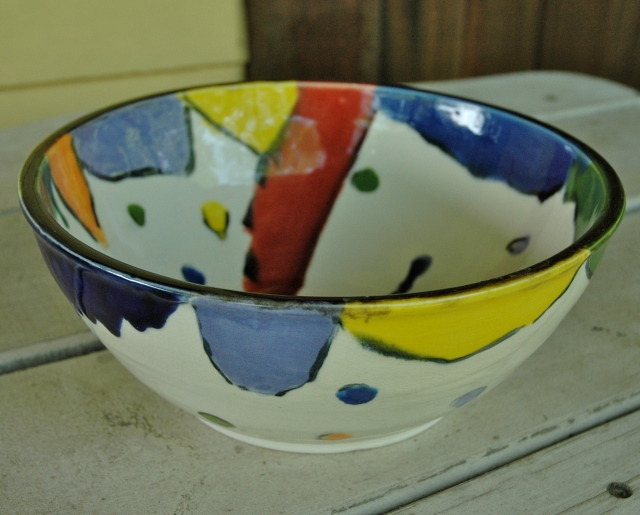 wheel-thrown bowl with whimsical designs