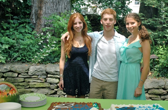 Triplets at their high school graduation party.
