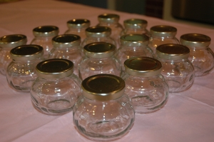 "Glass jars set up at ""body scrub station."""