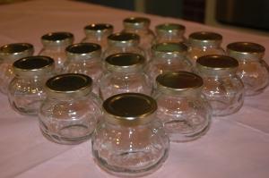 "Glass jars set up at ""body scrub station."""