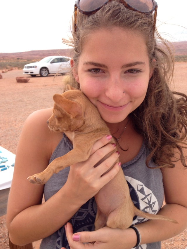 One of my teenage daughters holding 3 month old Chi Chi.