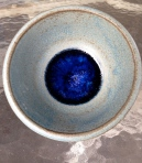 Marbles melted in the kiln created a royal blue bottom.