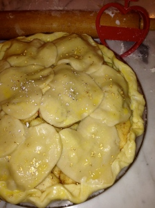 Apple pie, rolling pin and heart shaped cookie cutter.