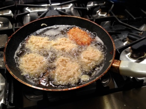 Latkes frying.