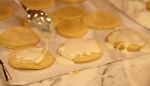 Cool cookies a few minutes,  prepare surface with parchment paper and ice cookies.