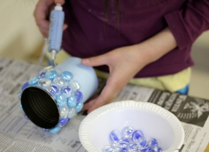 Applying glass marbles with glue gun.