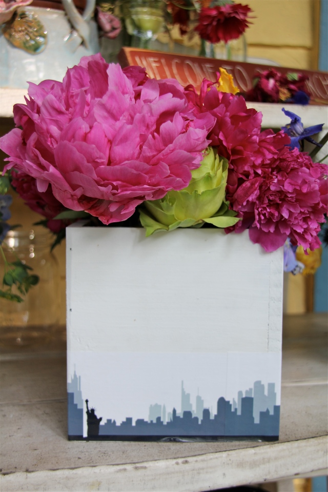 I love the contrast of the colorful flowers against the white box.