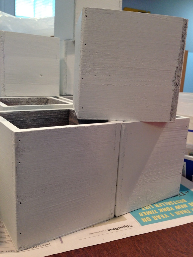 1. Unfinished wooden boxes were painted white with leftover wall paint.