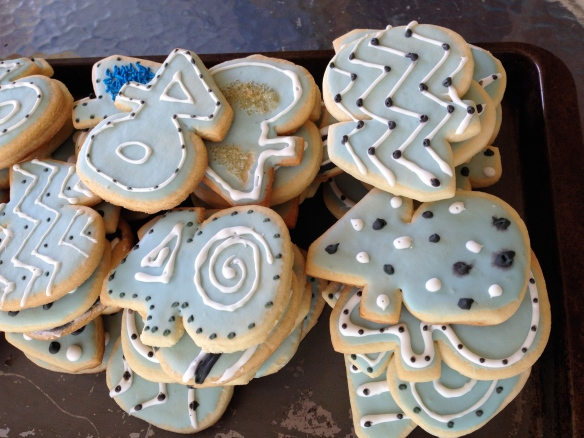 """40"" cookie cutters, blue and black Royal Icing and white squeezable icing were all part of the process.  Shout out to artist daughter who helped me decorate them."