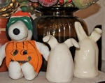 Snoopy-dressed-as-a-pumpkin and youngest daughter's ceramic bunnies welcome friends.