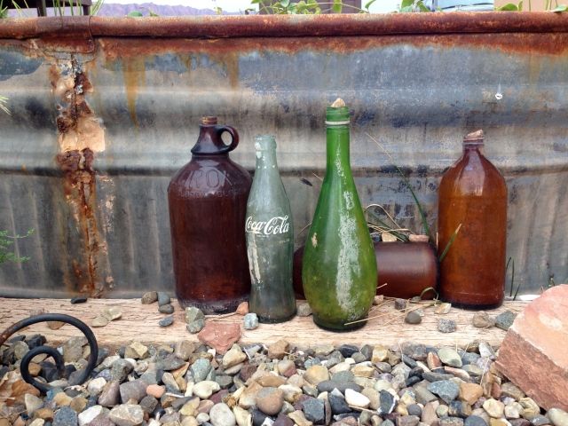 I found this collection of bottles set against a rusted tin tub appealing.  Maybe its the composition or color or maybe its because I see the extraordinary in the ordinary!