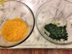 Shredded cheddar and steamed spinach.
