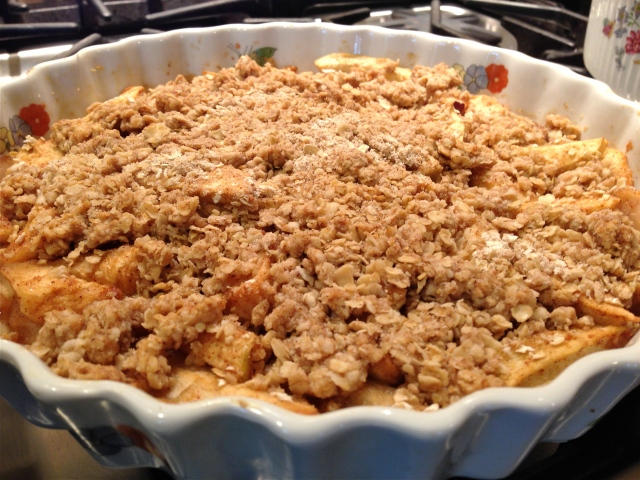 "Apple Crumble ready to eat.  ""I'll serve the Crumble and you dish out the ice cream!"""