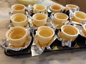 Line muffin tin cups with foil so cones will stand.