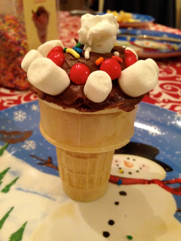 Cake-In-A-Cone with Icing and Extras. Yum!