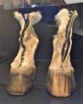"""Iris Schiefertein (German) 2006, """"Horse Shoes 3"""", horse fur, horse hoof, wood, zipper"""