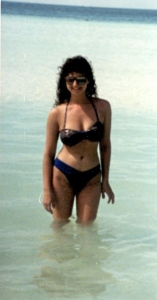 Hair and high-cut swimsuit--so Eighties!