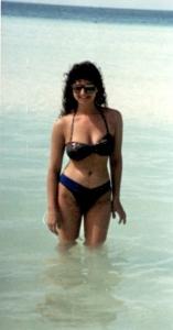 Hair and high-cut swimsuit--so Eighties!