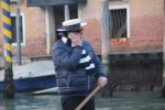Gondolier on his cell phone.
