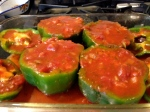 6. Pour tomato sauce mixture over peppers.   Bake.