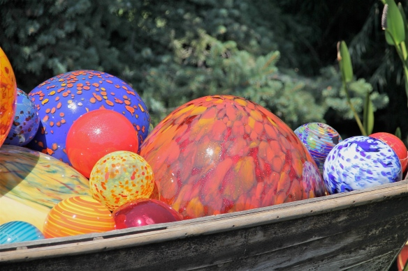 Dale Chihuly, Blown-glass spheres in a boat.