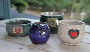 Small bowls with appliques and a tea light vessel.