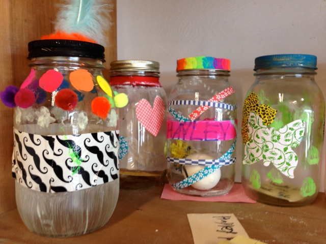 Colorful tape, stickers, paint markers, paint, pom poms and thread were used to decorate these jars.