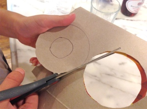 1. Fold a piece of cardboard in half. Trace a circle within a circle. Cut out circles.