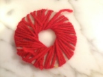 2. Wrap yarn around doubled cardboard circles.