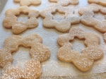 Sprinkle confectioner's sugar on top half of cookies.