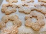 Sprinkle confectioner's sugar on top half of cookies.