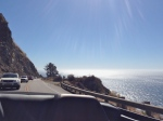 Driving up the coast with mountains on one side and the Pacific Ocean on the other.