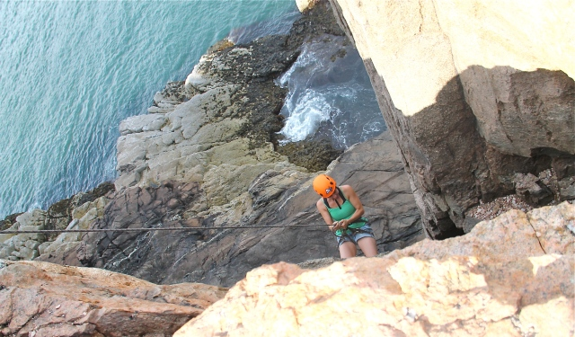 Rappeling down Otter Cliffs, Acadia National Park, Maine.