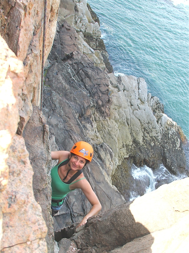 Rock climbing at Otter Cliffs, Acadia National Park, Maine.