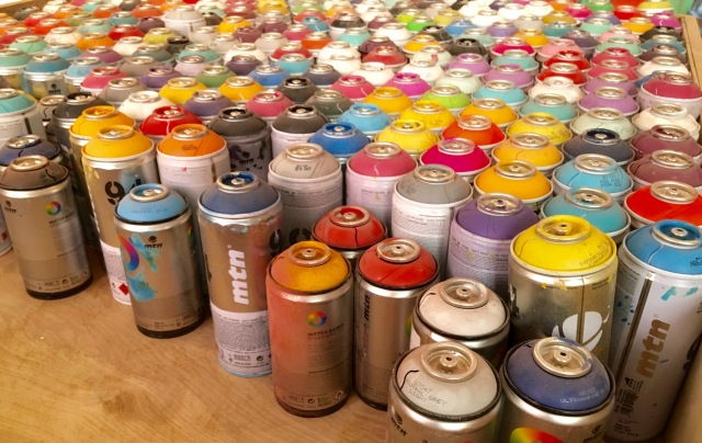 Spray paint cans.