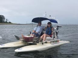 Teddy and Hannah on their boat.