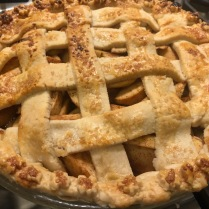 Basketweave crust with small leaf cutouts along the perimeter.