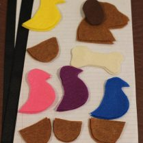 Cut out shapes. Sandwich ribbon between felt. Decorate.
